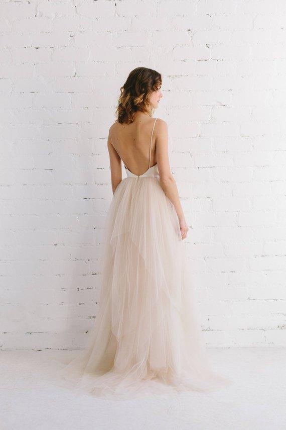 Robe de mariée en tulle blush • La Mariée